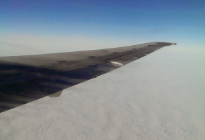 A plane wing, and clouds.